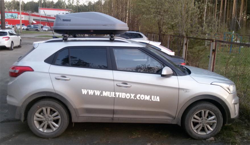 Thule Motion XT M black Kia Sportage